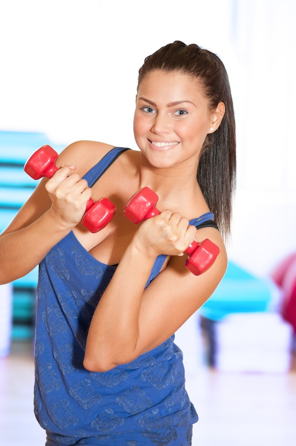 Woman doing power exercise at sport gym